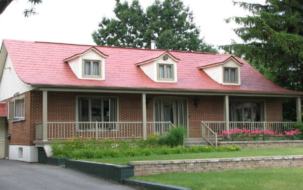 house with red shingles on roof