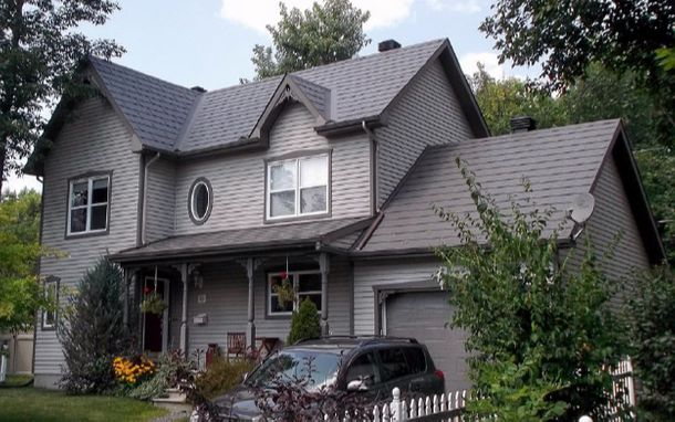 house with grey shingles on roof